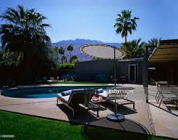 Lipoolandpatio by Pool And Patio Behind Modern House Stock Photo Getty Images