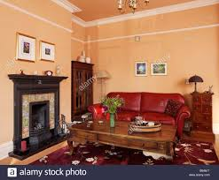 How To Decorate A Living Room With Red Leather Furniture Traditional Living Room With Red Leather Sofa And Wooden Coffee