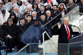 the purest meme of the inauguration is george w bush with his poncho
