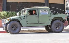 arnold schwarzenegger arrives in military hummer to take daughters