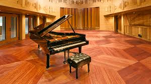 manifold grand piano set in spacious wooden room part of