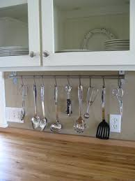 make the most out of your kitchen space consider hanging utensils