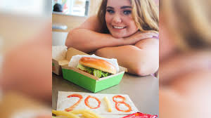 themed throws throws fries instead of cap in mcdonald s themed senior photo
