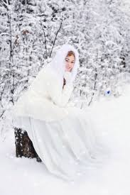 woman in white fur hooded dress in white snow filed free stock photo