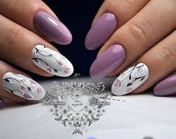 a lovely flower design on white nails combined with purple nails