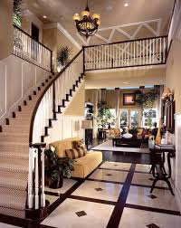 luxury home with straight staircase landing at the front of a