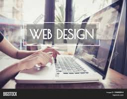 business hand typing on a laptop keyboard with web design homepage