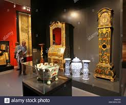 visitors look at pieces of furniture of the saxon polish court at