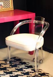white tone upholstered desk chair with clear acrylic frame of