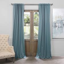 exclusive fabrics furnishings semi opaque dragonfly teal blackout curtain 50 in w