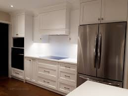 custom kitchen cabinets markham transitional kitchen with unify white cabinetry and floating
