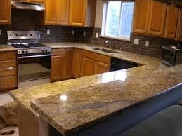granite countertops with glass backsplash in kitchen my home