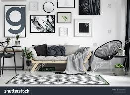 wooden sofa dark pillows scandi style stock photo 680854861