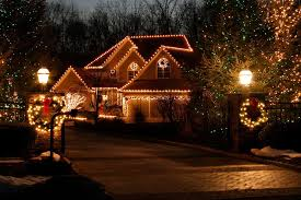 How To String Lights On Outdoor Tree Branches by Putting Up Outdoor Christmas Lights Is Easier With Expert Tips For