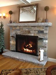 grey wall paint and white shelfs as stone fireplace surround plus