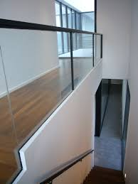 interior with wooden flooring and glass fence decoration in modern