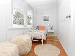 Small Bedroom Twin Beds Bedroom Modern Renovation Furry Pouf Picture Rail Round Area Rug