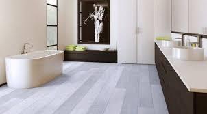 bathroom with clawfoot tub and vinyl flooring maintenance tips