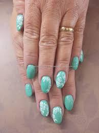mint of spring gel polish with white rose lace freehand nail art