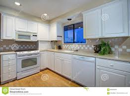 gray kitchen cabinets white appliances white kitchen design with hardwood floor and white