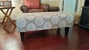 vintage tufted fabric cushioned coffee table with white painted