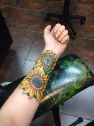 sunflower cover up tattoo done by jason reynolds at st louis