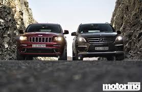 jeep grand mercedes 2012 mercedes ml 63 amg vs jeep gc srt8 motoring middle east