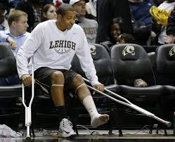 basketball player on bench lehigh university men s basketball team begins life without c j