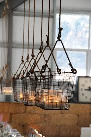 pulley system light fixtures hanging baskets wish i could put these on a pulley system from my