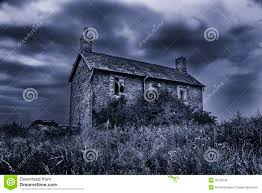 old run down spooky haunted house with stormy skies stock photo
