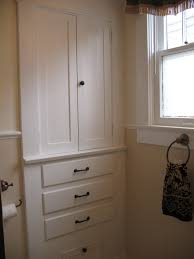 White Wooden Storage Cabinet With Drawers And Door Recessed White Wooden Bathroom Cabinet With Numerous Drawers And