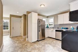 white kitchen cabinets with tile floor kitchen room interior with white cabinets and tile floor 120564736
