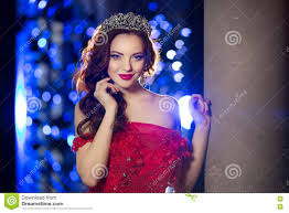 woman in lux dress with crown like queen princess lights party