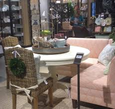 seen around town ballard designs new retail store nestfeathers pedestal table banquette and wicker dining chairs