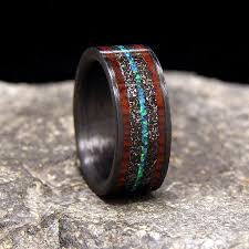 meteorite wedding band meteorite shavings cocobolo band and blue green lab opal inlays