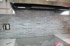 how to install a mosaic tile backsplash in the kitchen installing a paper faced mosaic tile backsplash