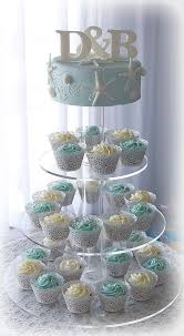 sea star beach theme wedding cake and cupcake tower flickr