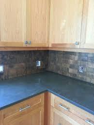 splendid copper backsplash ideas with dark gray granite countertop