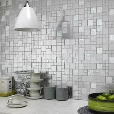 modern white pendant lamps and stylish silver wall tiles for