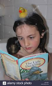 young in the bath reading the ugly duckling story to her real