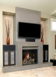 Tv In The Middle Of The Living Room by Black Fireplace On The Gray Wall Plus Shelf And Tv Above Placed On