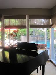 protecting pianos here with woven wood shades plum designs and