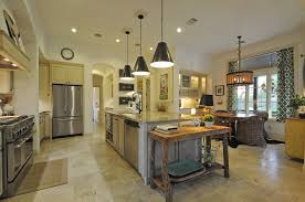 pendants over a dining room table or kitchen island featured