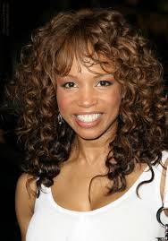 pictures of spiral perms on long hair elise neal wearing her long hair with a spiral perm for curls