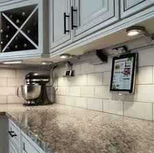 adorne under cabinet lighting system for convenient access to power and light in your kitchen the