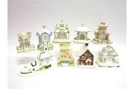 a collection of coalport porcelain houses buildings comprising
