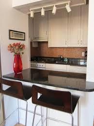 romantic kitchen island design with bar and black granite