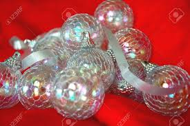christmas ornaments irridescent balls and silver ribbon on