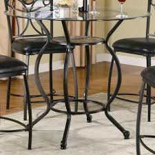 black polished wrought iron with rounded glass top dining table