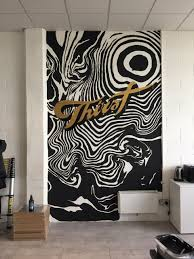 rachel millar to paint a mural on the wall of their studio designed by thirstcraft designers i brought it to life by adding swirling matt black shapes and shiny